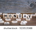 monday from wooden letters on... | Shutterstock . vector #523515388