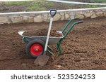 two wheeled wheelbarrow loaded...   Shutterstock . vector #523524253