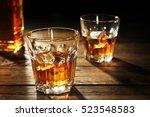 glasses of whisky on wooden...   Shutterstock . vector #523548583