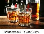 glasses of whisky on wooden bar ... | Shutterstock . vector #523548598