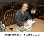 "Small photo of HUNTINGTON, NY-NOV 16: Andy Cohen signs copies of his book ""Superficial: More Adventures from the Andy Cohen Diaries"" at Book Revue on November 16, 2016 in Huntington, New York."