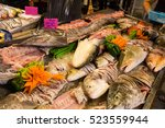 seafood in the basket for dinner | Shutterstock . vector #523559944