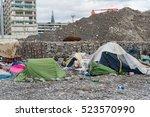 migrant tent in genoa beach ...   Shutterstock . vector #523570990