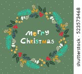 handdrawn christmas wreath.... | Shutterstock .eps vector #523573468