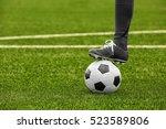football player holding ball... | Shutterstock . vector #523589806