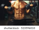 athletic man training with... | Shutterstock . vector #523596010
