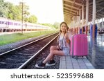 girl waiting train on the