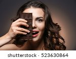 beautiful girl with chocolate... | Shutterstock . vector #523630864