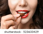 girl eating chocolate  closeup | Shutterstock . vector #523633429