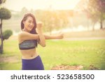 athletic woman asian warming up ... | Shutterstock . vector #523658500