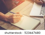 businessman write on notebook... | Shutterstock . vector #523667680