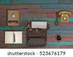 vintage typewriter and coffee... | Shutterstock . vector #523676179