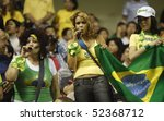 SHANGHAI - SEPTEMBER 30:  Brazilian supporters cheer their team during the Women's World Cup soccer final between Brazil and Germany September 30, 2007 in Shanghai, China. - stock photo