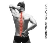 Small photo of Spine pain, man with backache and ache in the neck, black and white photo with red backbone on gray background