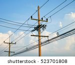 utility poles supporting wires... | Shutterstock . vector #523701808