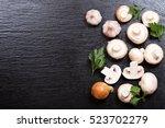 fresh champignon mushrooms on...   Shutterstock . vector #523702279