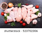 fresh chicken meat on dark... | Shutterstock . vector #523702306