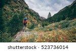 hiking italian alps   Shutterstock . vector #523736014