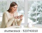 beautifur girl with smartphone | Shutterstock . vector #523743310