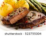 grilled beef steaks and... | Shutterstock . vector #523755304