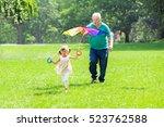 happy grandfather helping kid...   Shutterstock . vector #523762588