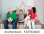 family of soccer fans watching... | Shutterstock . vector #523762663