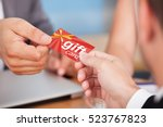person giving gift card | Shutterstock . vector #523767823