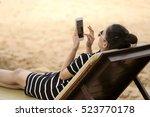 Beautiful Girl Sit On Chair...