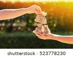 a man and a women hands hold a... | Shutterstock . vector #523778230