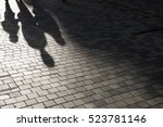 people shadow on the pavement | Shutterstock . vector #523781146