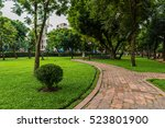 walkway in green city park | Shutterstock . vector #523801900