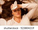 illness woman having headache... | Shutterstock . vector #523804219