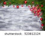 christmas fir tree on wooden... | Shutterstock . vector #523812124
