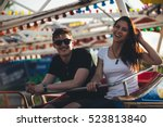 siblings at an amusement park.... | Shutterstock . vector #523813840