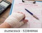worker injured hand filling a... | Shutterstock . vector #523848466