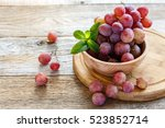 bowl with pink grapes on a...