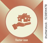 house in hand vector icon. | Shutterstock .eps vector #523854478