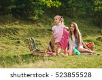 mother and daughter at a picnic ... | Shutterstock . vector #523855528