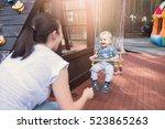 mom swinging baby boy in swing...   Shutterstock . vector #523865263