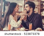 young couple enjoying coffee... | Shutterstock . vector #523873378