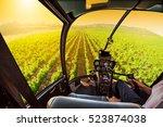helicopter cockpit flies in... | Shutterstock . vector #523874038