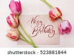 bouquet of red tulips on white... | Shutterstock . vector #523881844