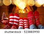 family in christmas socks near... | Shutterstock . vector #523883950