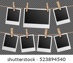retro photo frames hanging on... | Shutterstock . vector #523894540