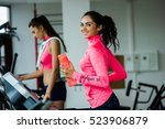 two young sporty women run on... | Shutterstock . vector #523906879