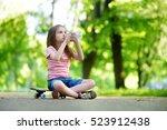 pretty little girl drinking... | Shutterstock . vector #523912438