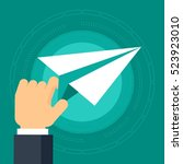 paper plane in hand of the... | Shutterstock .eps vector #523923010