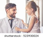Cute Little Girl Is Examining...