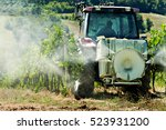 Small photo of tractor spraying weed killer in a vineyard