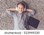 top view of little boy in... | Shutterstock . vector #523949230